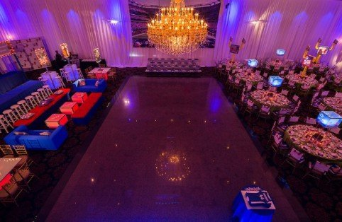 Dance floor, dining room, bleachers and teen VIP lounge area at a Football Themed Bar Mitzvah | X-Quisite Flowers & Events