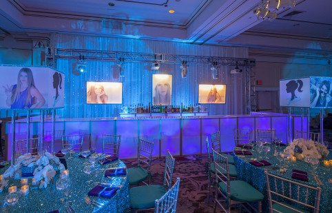 Purple LED light up bar with dimensional light up boxes with blown up photos and turquoise sequined frames decor by X-Qusite Flowers & Events in Westchester for a Bat Mitzvah