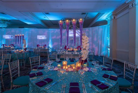 Table design and centerpieces for a Westchester turqoise and purple Bat Mitzvah by X-Quisite Flowers & Events