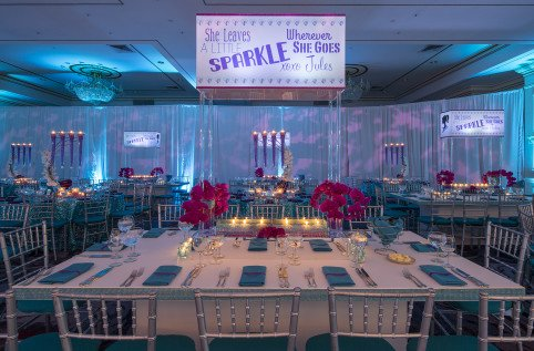 Custom lighting, table decor and flowers by X-Quisite Events