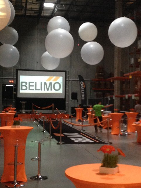 Belimo Warehouse Corporate Party orange and white theme colors