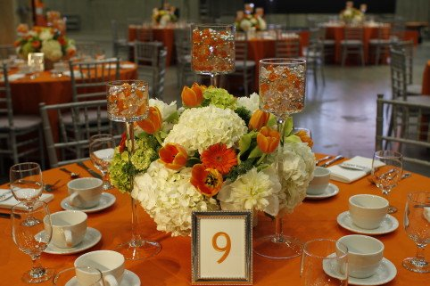 Orange and white floral centerpieces